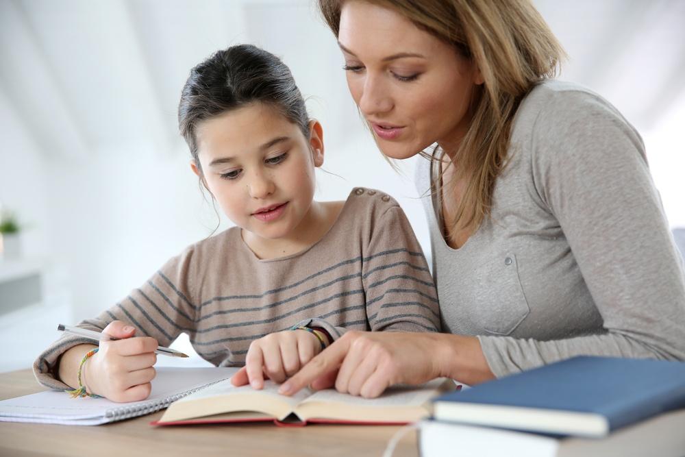 Mom helping kid with homework