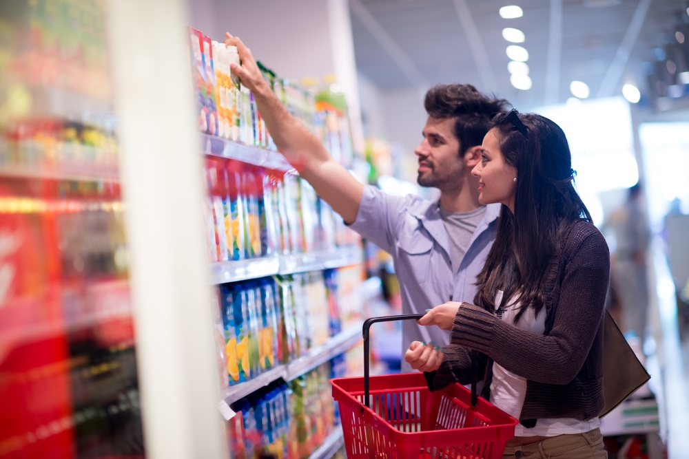 Young couple shopping in a supermarket.jpeg