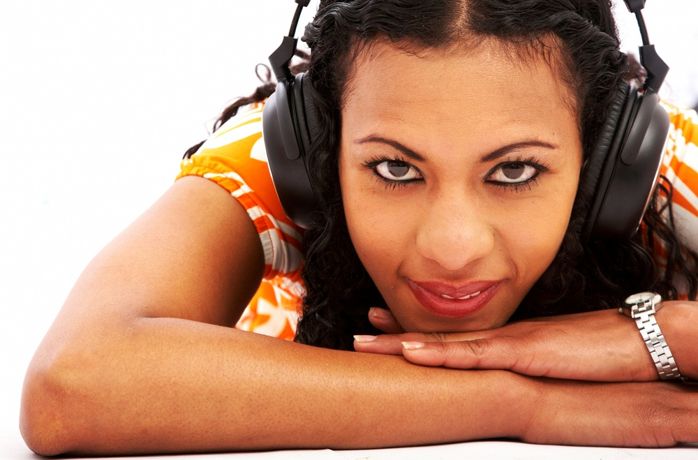 black girl listening to music looking happy over white.jpeg