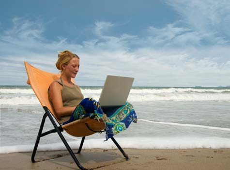 Small-Business-Owner-Working-Remotely-While-on-Vacation