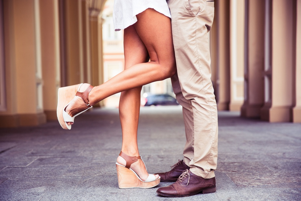 Closeup portrait of a Male and female legs during a date.jpeg