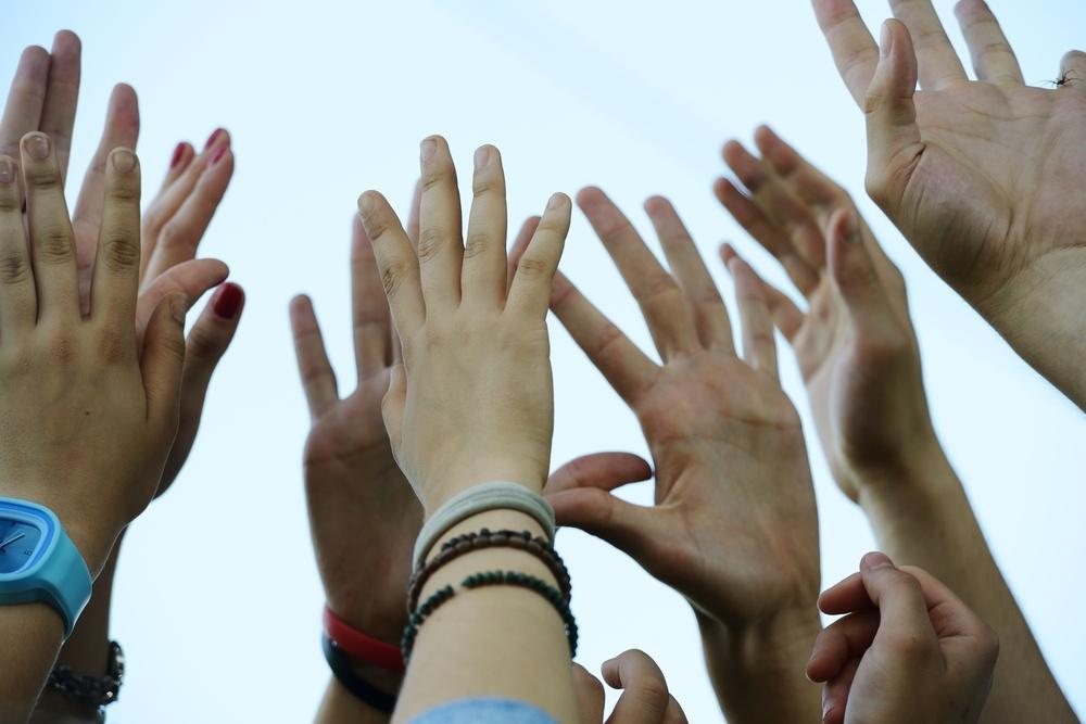 Group raising hands.jpeg