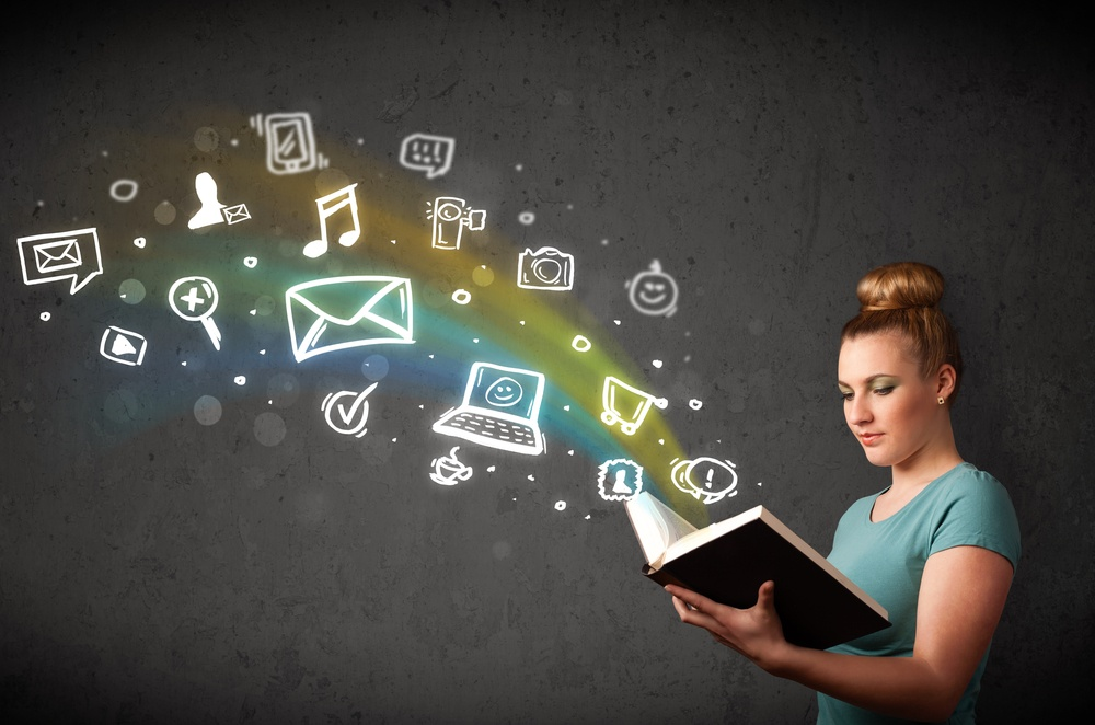 Young lady reading a book with multimedia icons coming out of the book.jpeg